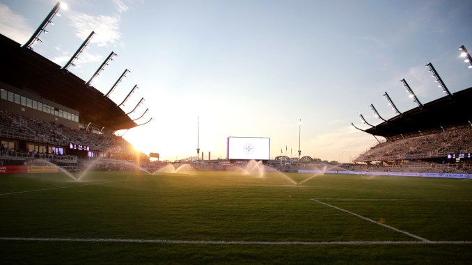 The sun sets over Lynn Family Stadium.
