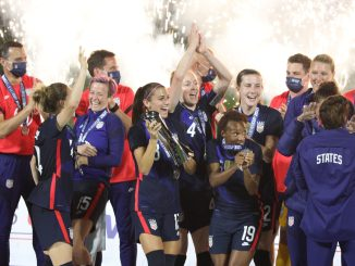 Team USA players and staff celebrate after winning the 2021 SheBelieves Cup.
