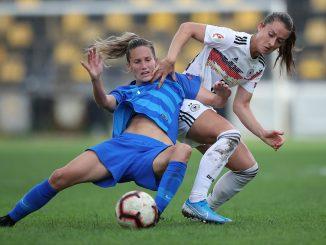 Sara Daebritz of Germany tackles Eleni Kakambouki of Greece.