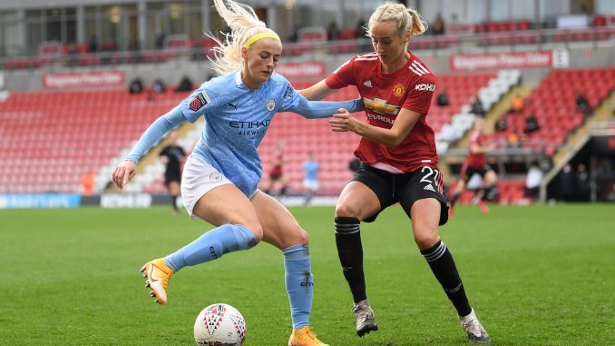 Chloe Kelly of Manchester City is challenged by Millie Turner of Manchester United.