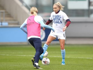 Manchester City's Steph Houghton warms up prior to kick-off.
