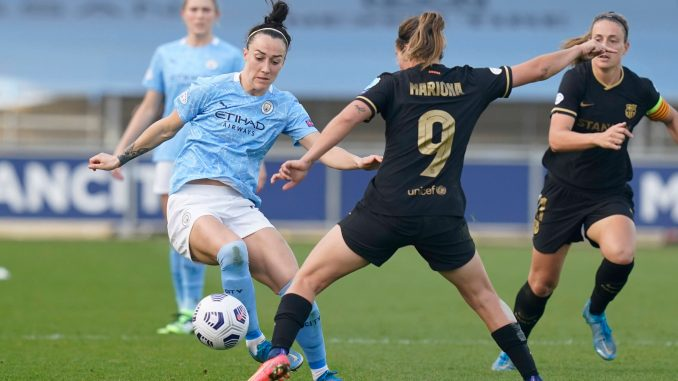 Manchester City's Lucy Bronze takes on Marion Caldentey of FC Barcelona.