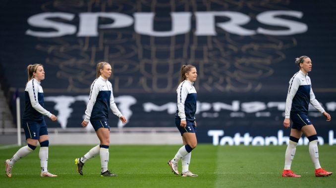 Alanna Kennedy (right) leads Tottenham Hotspur teammates onto the pitch.