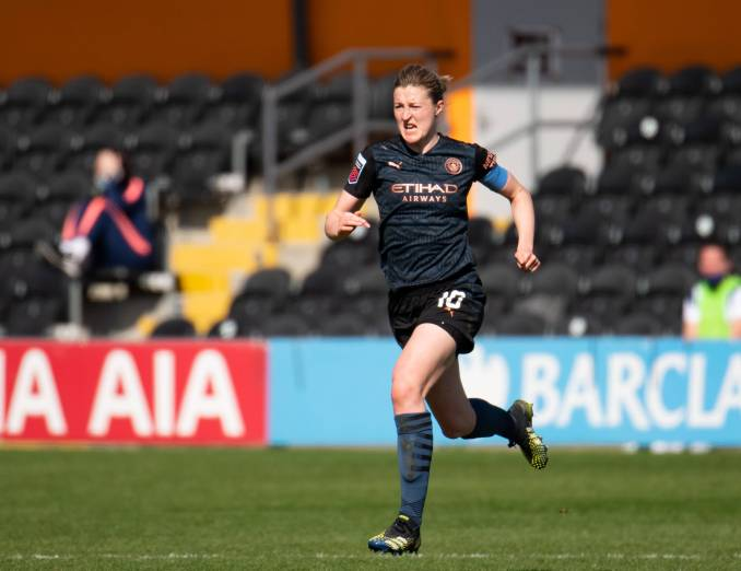 Manchester City's Ellen White runs across the pitch.