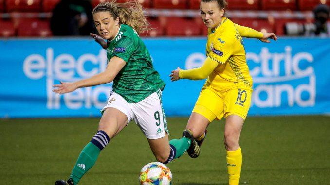 Simone Magill and Nadia Kunina battle for the ball.