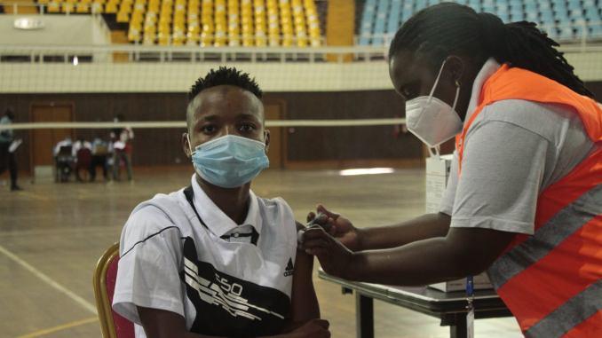 Mwanalima Adam receives COVID-19 vaccine.