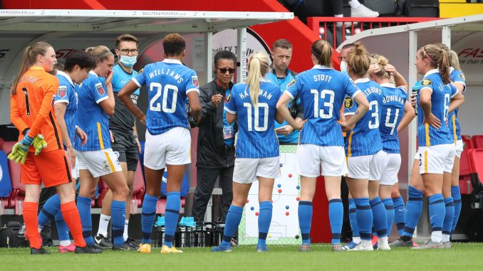 Brighton manager Hope Powell gives a team talk.