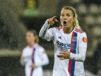Ada Hegerberg gestures to teammates.