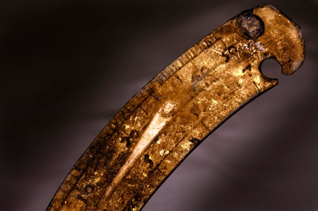 A close up of the scale on a copper alloy navigational instrument that was partially buried in the silt. The silted, anaerobic environment of the Thames Estuary is perfect for preserving such fine detail. (c) Luke Mair