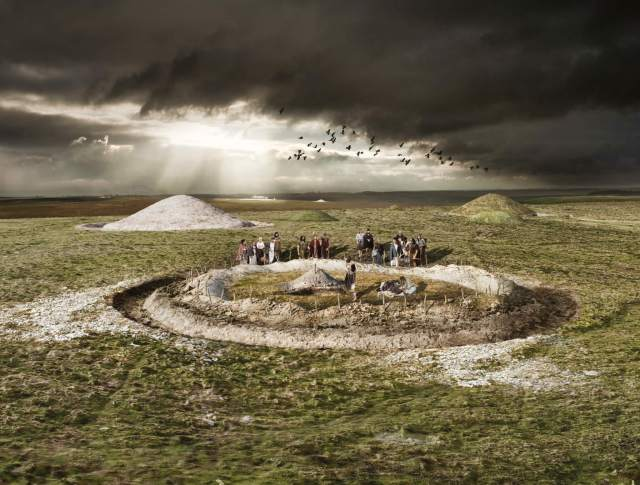 An illustrated reconstruction of a burial within a round barrow, around 1900 BC, during the Early Bronze Age © Peter Lorimer