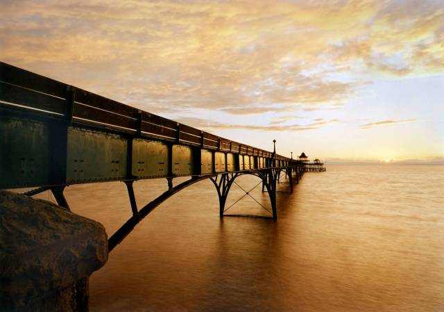 exterior oblique view - sunset clevedon pier avon north somerset clevedon