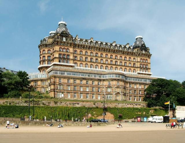 The Scarborough Grand Hotel, standing in front of the famous beach © Historic England