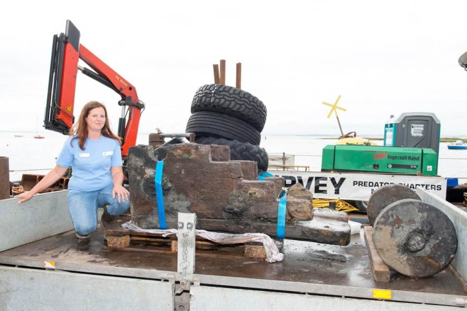 alison-james-maritime-archaeologist-at-historic-england-with-gun-carriage-from-the-wreck-of-the-london-at-leigh-on-sea-c-historic-england