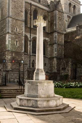 Rochester War Memorial, Kent. Unveiled 1922. Newly listed at Grade II. This Portland stone memorial stands between Rochester Cathedral and the High Street. It remembers the sacrifice made by members of the local community who lost their lives in the First World War. The principal inscription reads: LEST WE FORGET 1914-1918 - a phrase from Rudyard Kipling's 1897 poem 'Recessional.' A number of recurrent Baker memorial themes are represented here - a cross with an octagonal shaft, a reversed sword and Crusader warship in low relief, and an octagonal plinth with steps.