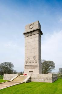 The Cenotaph, Rickerby Park, Carlisle, Cumbria, designed by Sir Riobert Lorimer. Unveiled 25 May 1922. Upgraded to Grade II*. © Historic England DP169615. Sir Robert Lorimer's commanding granite cenotaph stands 12 metres high in Rickerby Park. The park was altered in 1920-1921 to form a war memorial park and has been newly listed at Grade II. The memorial commemorates the fallen of the old counties of Cumberland and Westmorland (now Cumbria). It carries the crests and insignia of the two counties' Cumberland Artillery, Cumberland and Westmorland Yeomanry, and of the Border Regiment which fought at Passchendaele, along with those of the Army, Navy, Royal Air Force and the medical services. Lorimer was a distinguished Scottish architect and designer who also created the great memorials to the missing of Chatham, Plymouth and Portmouth, as well as the magnificently imposing Scottish National War Memorial at Edinburgh Castle.