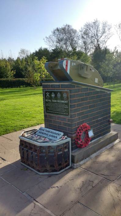 A modern memorial depicting a Mark V Heavy Tank commemorates the Royal Tank Regiment at the National Memorial Arboretum, Alrewas, Staffordshire. The memorial is located within the Regiment's grove of ash trees, some of which have been propagated from trees growing on the original Cambrai battlefield. During recent conservation, a container for the Royal British Legion's Poppy Crosses was constructed from armoured vehicle track and placed at the foot of the memorial. Daffodils planted in the pattern of tank tracks bloom in the spring © John Hughes.