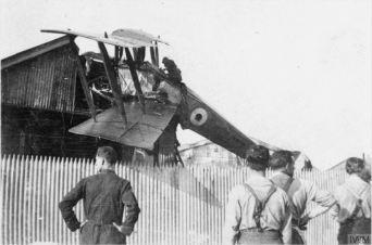 RFC bi-plane crashed on a hangar's roof © IWM Q72914.