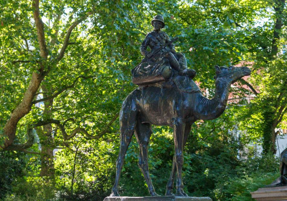 Imperial Camel Corps Memorial statue of a soldier sitting on a camel, Victoria Embankment Gardens, London.