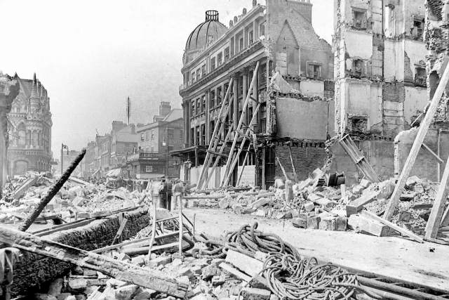 The rubble of Havelock House is in the foreground, with the Elephant Tea Rooms behind
