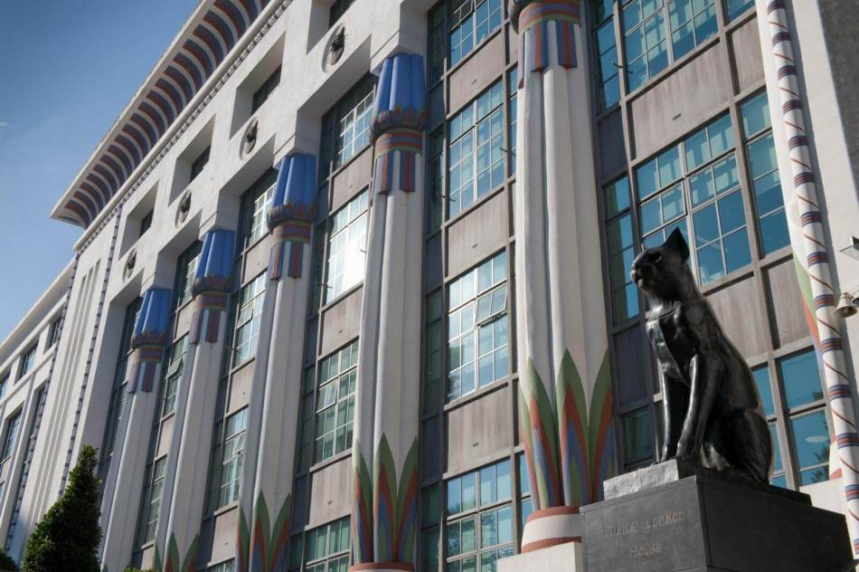 Exterior of Greater London House including statue of a cat