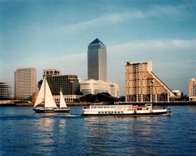 A view across the Thames towards One Canada Squarewith boats in the foreground