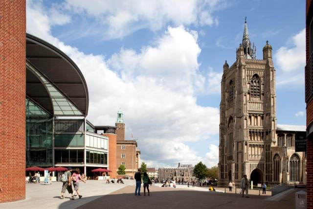 View of people walking through the square with St Peter Mancroft Church on the right