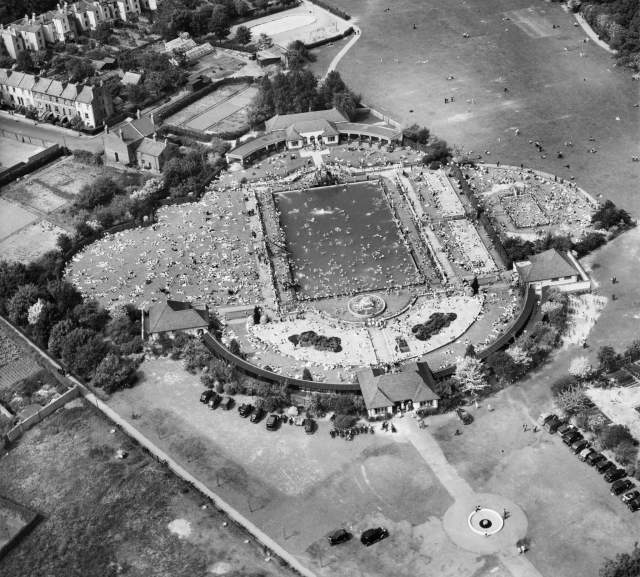 Crowds at Sandford Swimming Pool, Cheltenham seen from above