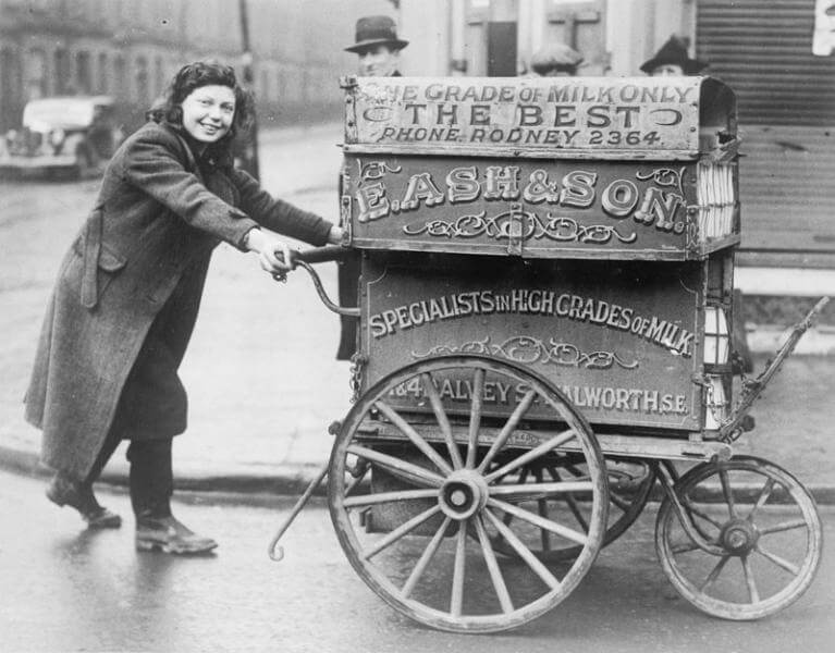 15 year old Rose Brown from Walworth, south-east London, on her rounds with her milk barrow
