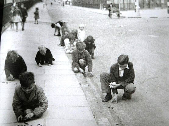 Children collecting shrapnel in a London street