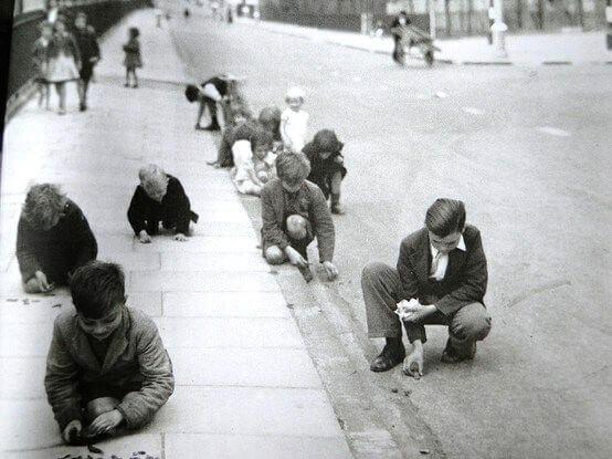 Children collecting shrapnel in a London street