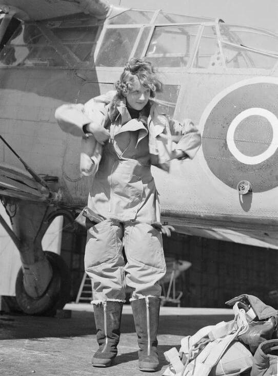 A Wren radio mechanic prepares for a flight to test new radio equipment