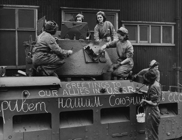 Workers at Ruston & Hornsby's factory, Lincoln, paint a Matilda tank prior to its dispatch to Britain's ally Russia. The Russian script is a translation of the English words above: 'Greetings to our allies in USSR.'