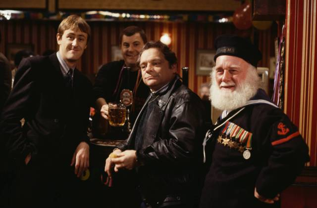 Actors (L-R) Nicholas Lyndhurst, David Jason and Buster Merryfield in a pub scene from episode 'The Chance of a Lunchtime' of the television sitcom 'Only Fools and Horses', December 2nd 1990. (Photo by Don Smith/Radio Times/Getty Images)