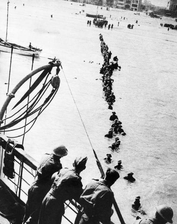 Soldiers wading out to a rescue ship