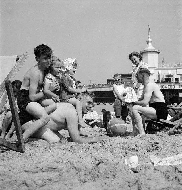 A family enjoying the sunshine on the beach at Blackpool, 1946-1955 © Historic England Archive. Ref: AA086159