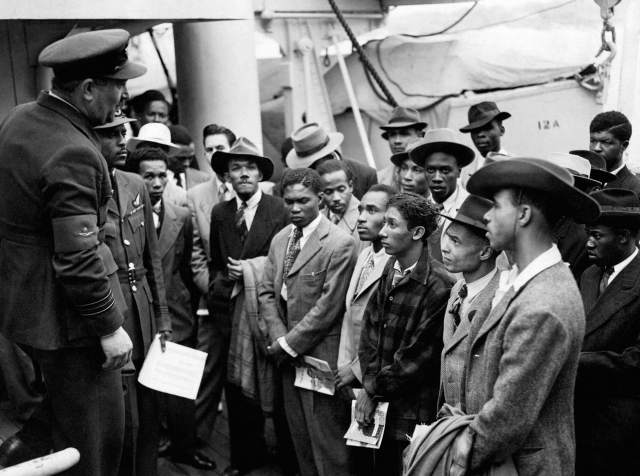 Men are met as they get off the Empire Windrush