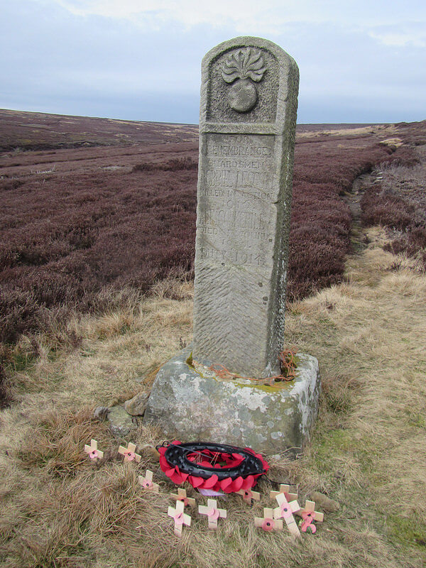 Commondale Shepherds War Memorial with small crosses and a wreath at the base