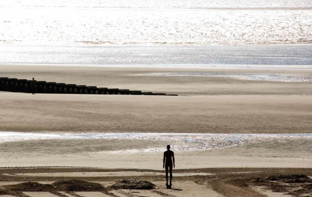 'Another Place' at Crosby beach by Antony Gormley © Historic England Archive. Ref: DP034505