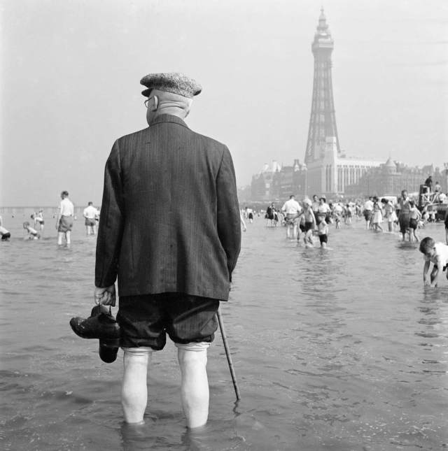 Elderly man paddling in the sea, with Blackpool Tower in the background, 1946 - 1955 © Historic England. Ref: AA047928