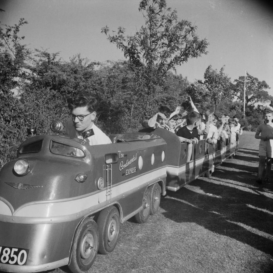 Children taking a ride on a miniature train