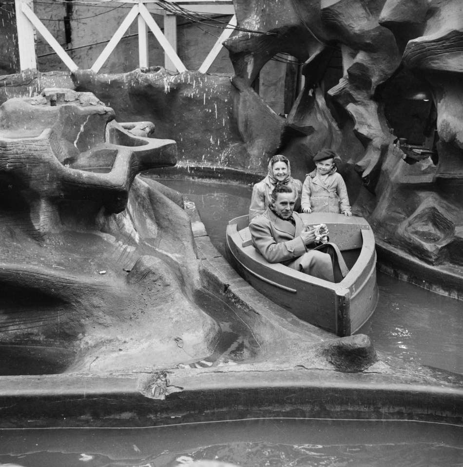 A couple with a young boy on a water-ride during a day trip to Skegness