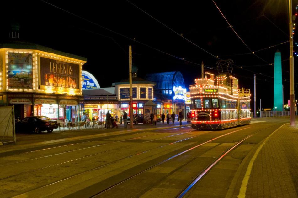 Illuminations on Promenade, Blackpool. Lancashire, showing illuminated tram and North Pier © Historic England Archive DP129904