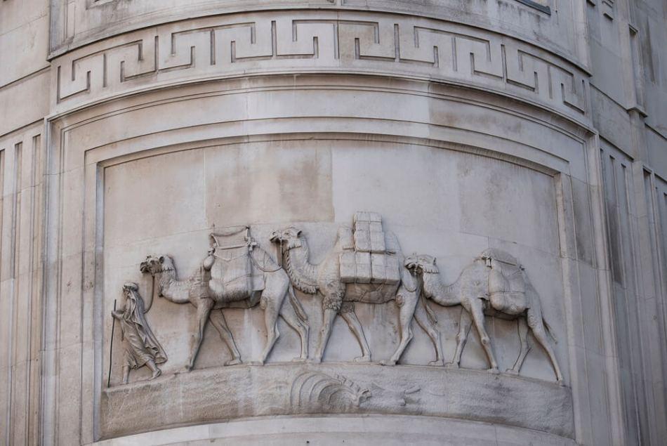 Stone relief of a camel caravan