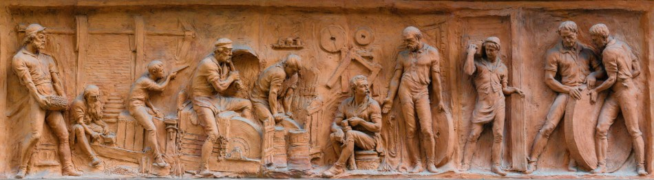 Terracotta frieze of cutlers at work