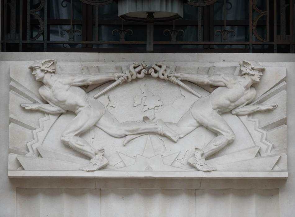 stone relief of two identical sculptures represents the Roman messenger god, Mercury