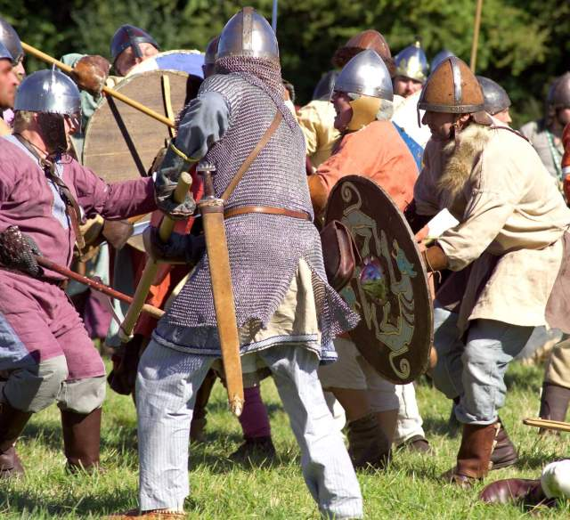 Photograph showing a modern re-enactment of a battle with the Vikings.