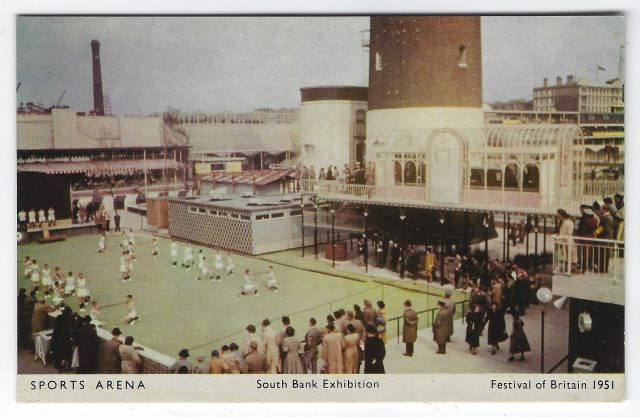 Postcard - people gather to watch sports demonstrations in the open air, outside the Sports arena.