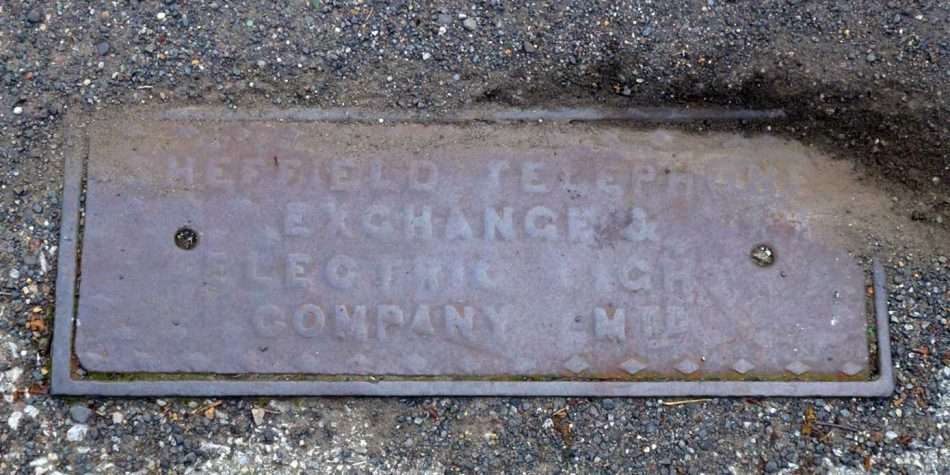 A thin rectangle manhole cover with the text: 'Sheffield telephone exchange, electric light company ltd'