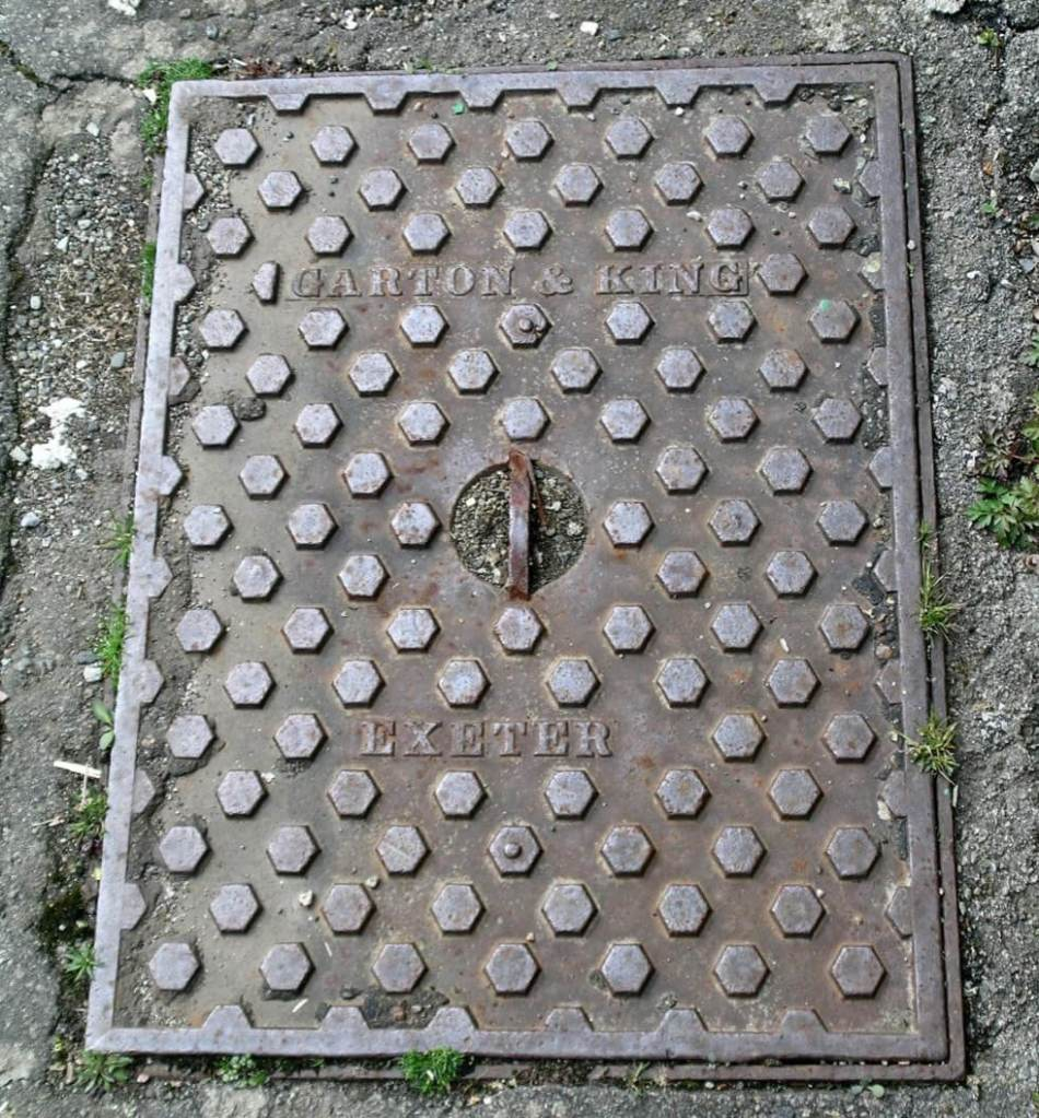 Manhole cover with text 'Garton & King, Exeter.'