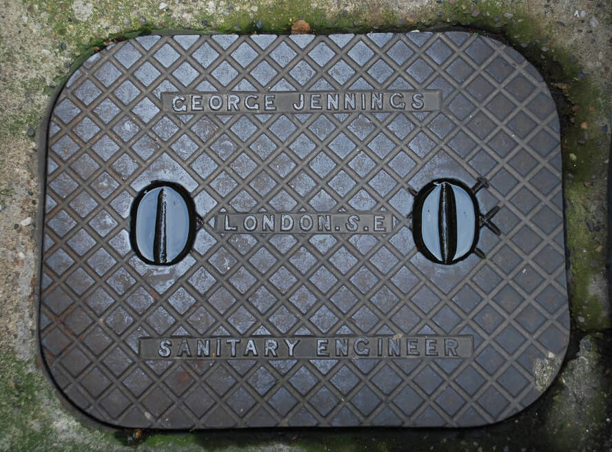 Manhole cover with 'George Jennings, London S.E, Sanitary Engineer'